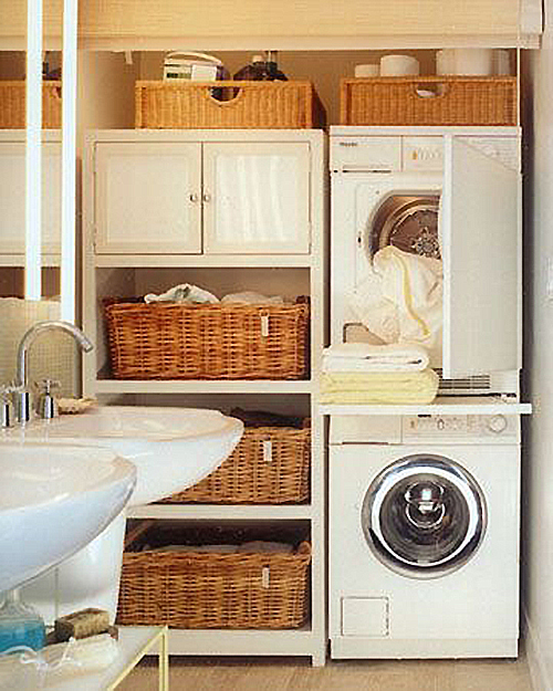 shared laundry bathroom space with beautiful baskets for storage featured on Remodelaholic.com