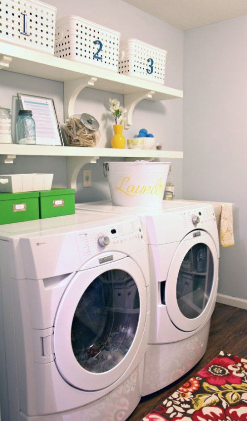 simple Laundry Room with open shelves and storage baskets featured on Remodelaholic.com