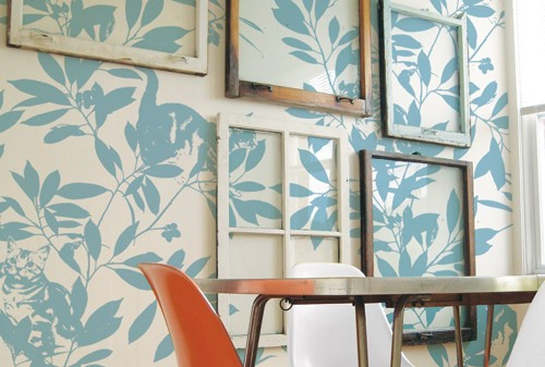source unknown - salvaged old window gallery wall on patterned wallpaper - via Remodelaholic