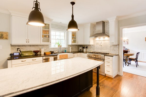white kitchen renovation with brass industrial lighting and marble on Remodelaholic