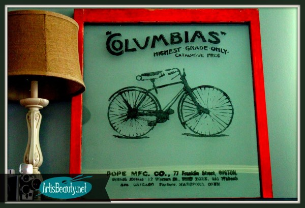 Art Is Beauty - vintage bike advertisement painted on an old window
