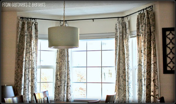 damask stenciled curtains - featured on Remodelaholic