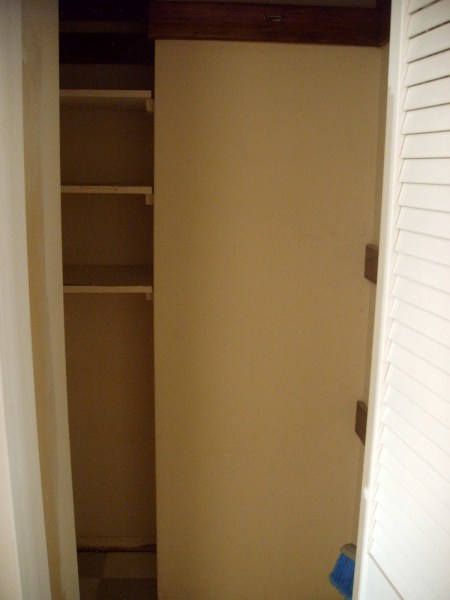 pantry before barn door and new shelving, Girl Meets Carpenter on @Remodelaholic