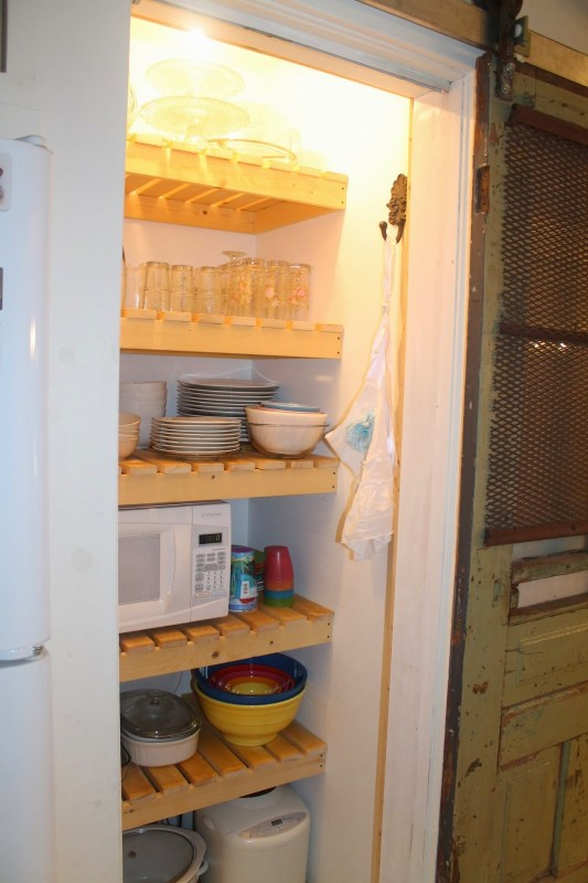 use pantry wood slat shelves to store dishes instead of food, Girl Meets Carpenter on @Remodelaholic