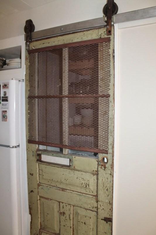 vintage door turned barn door for pantry, Girl Meets Carpenter on @Remodelaholic