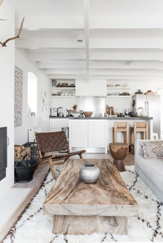white room with wood table