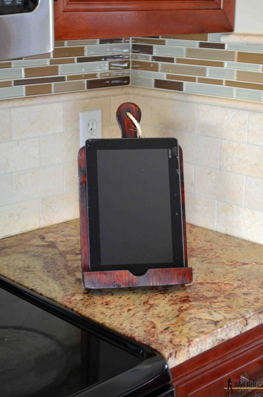 If you like cooking using online recipes a tablet holder or Ipad holder is a must. Build a DIY bread board kitchen tablet holder with this easy tutorial. @Remodelaholic