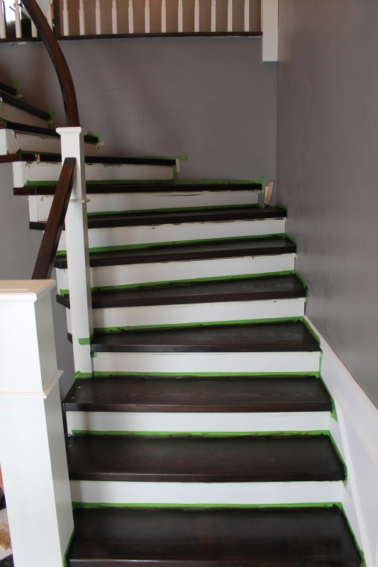 painted and stained staircase remodel in process - Construction2Style via @Remodelaholic