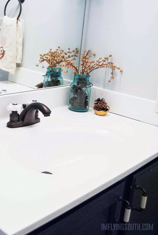 DIY Painted Bathroom Sink and Countertop Tutorial - I'm Flying South featured on @Remodelaholic