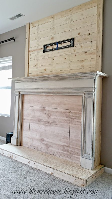 DIY faux fireplace with plank wall chimneypiece - Blesser House featured on @Remodelaholic
