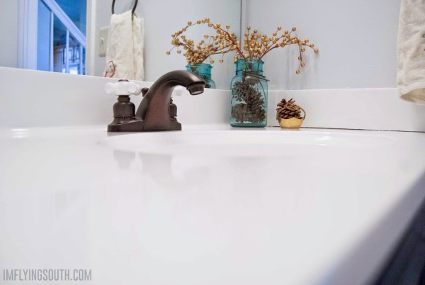 DIY painted bathroom sink and counter - I'm Flying South featured on @Remodelaholic