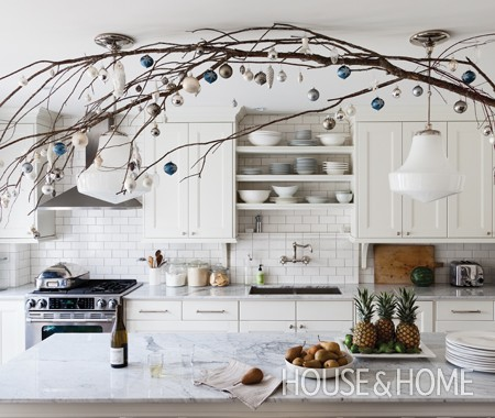 branches and ornaments to decorate overhead for Christmas - House and Home via @Remodelaholic