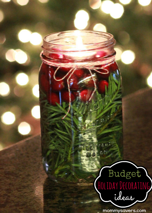 floating tealight in a jar with pine and cranberries - Mommy Savers via @Remodelaholic