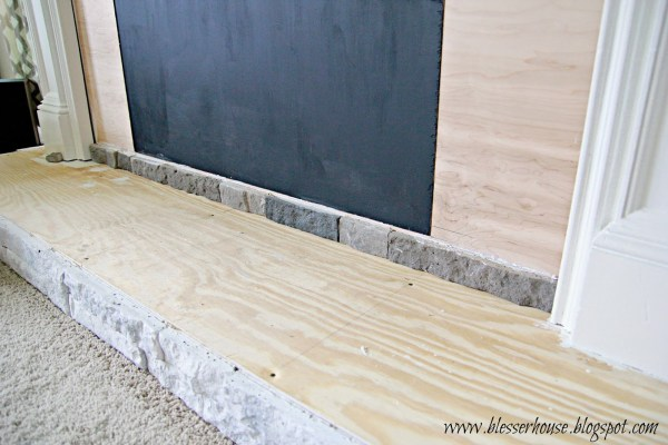 hearth base with airstone for faux fireplace - Blesser House featured on @Remodelaholic