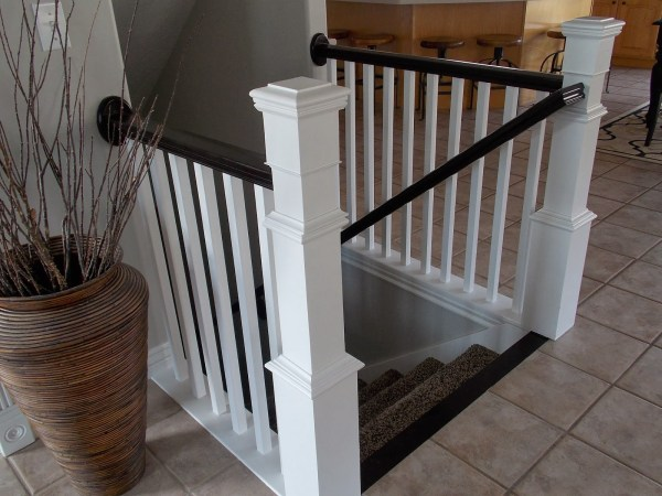 how to build a newel post around an existing banister - TDA Decorating and Design featured on @Remodelaholic