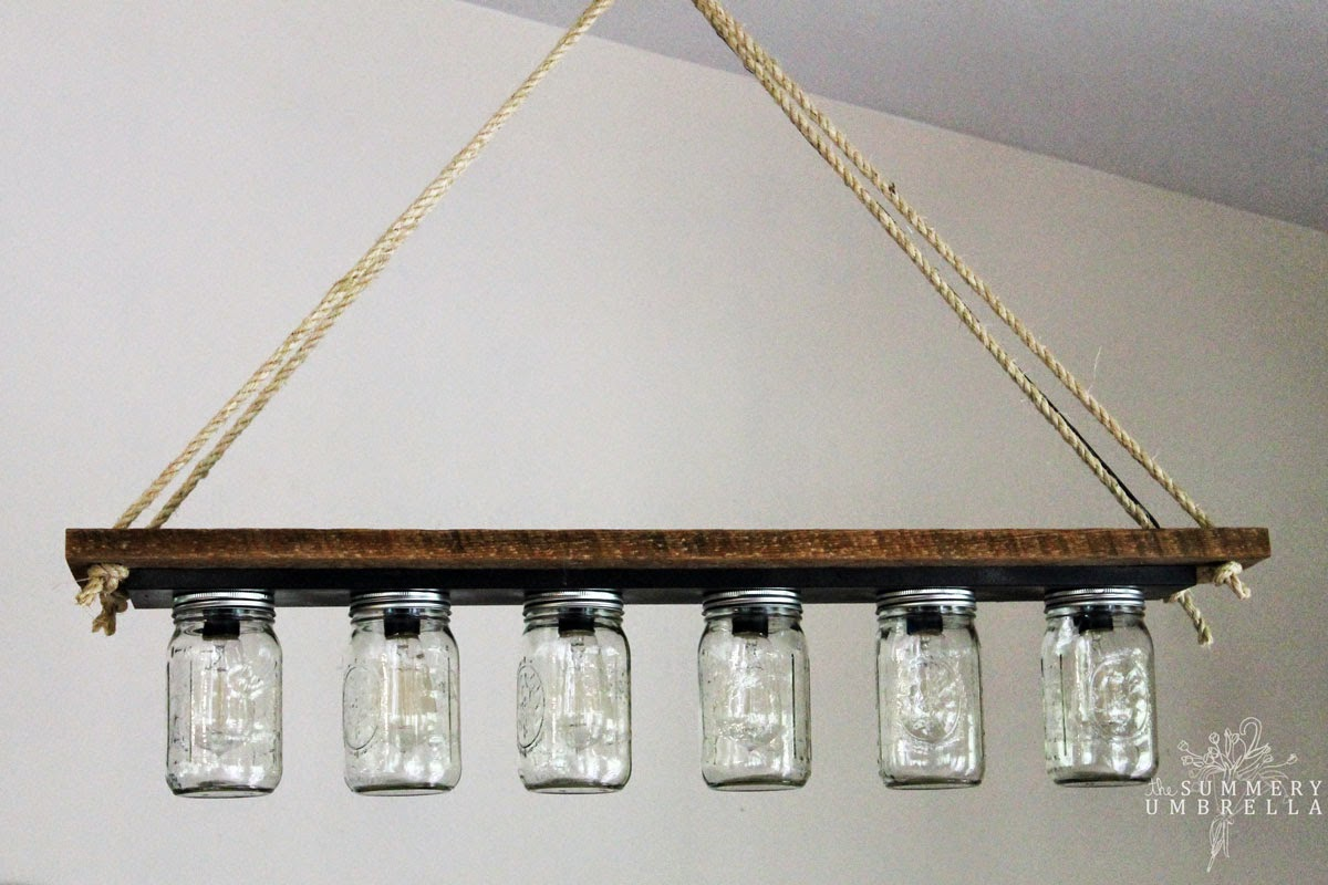Remodelaholic upcycle a vanity light strip to a hanging pendant light mason jar pendant chandelier light from bathroom vanity light strip the summery umbrella featured on arubaitofo Choice Image