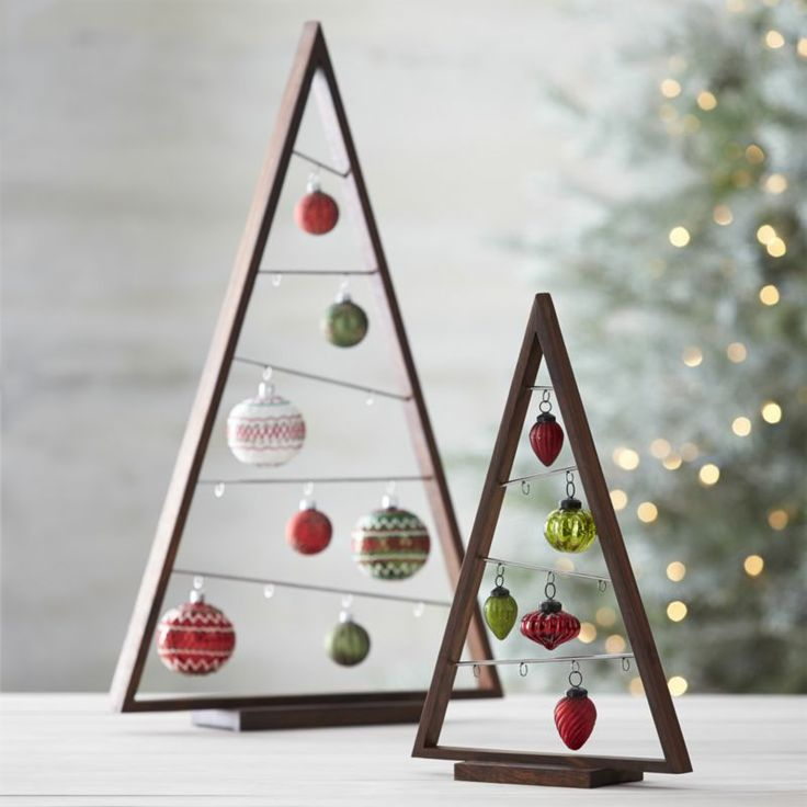 ornament display tree from crate and barrel. BUT… it's no longer available  in wood, only in metal. And I LOVE the rustic feel of the deep stained wood. - Remodelaholic DIY Ornament Display Tree