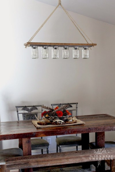 rustic mason jar and wood hanging chandelier pendant light DIY - The Summery Umbrella featured on @Remodelaholic