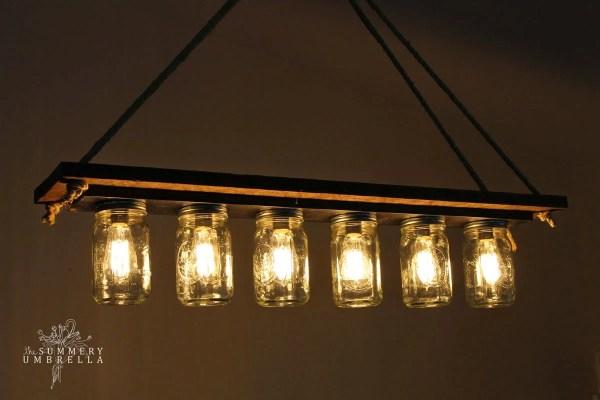rustic wood mason jar chandelier tutorial - The Summery Umbrella featured on @Remodelaholic
