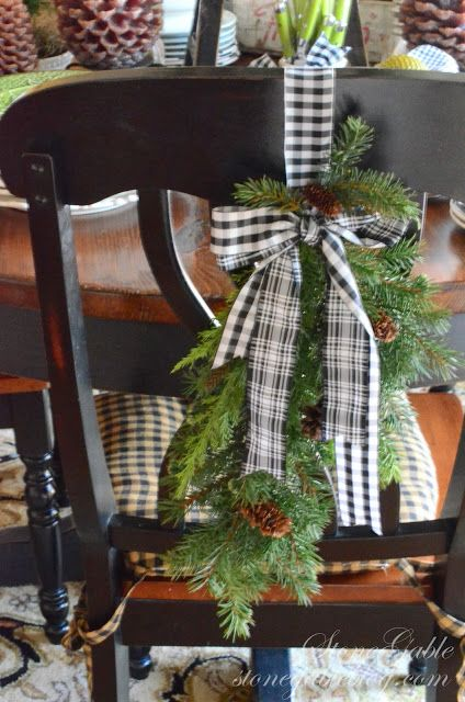 use a pine swag to decorate dining chairs - Stonegable Blog via @Remodelaholic