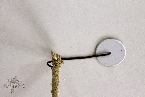 use rope to hide a rustic chandelier cord - The Summery Umbrella featured on @Remodelaholic