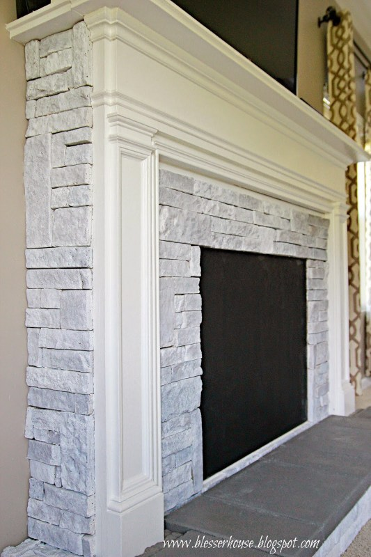white painted airstone faux fireplace - Blesser House featured on @Remodelaholic
