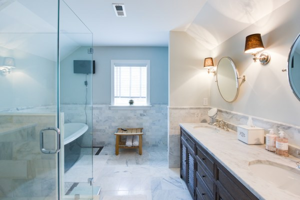 (Coventry) large white bathroom with marble and dark double vanity and mirrors @Remodelaholic