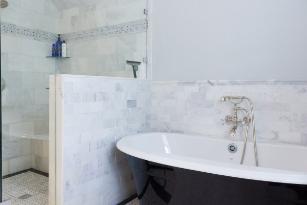 (Coventry) white marble walk-in shower with black and white standalone tub and marble surround @Remodelaholic