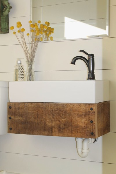 DIY floating vanity from reclaimed wood - Girl Meets Carpenter featured on @Remodelaholic