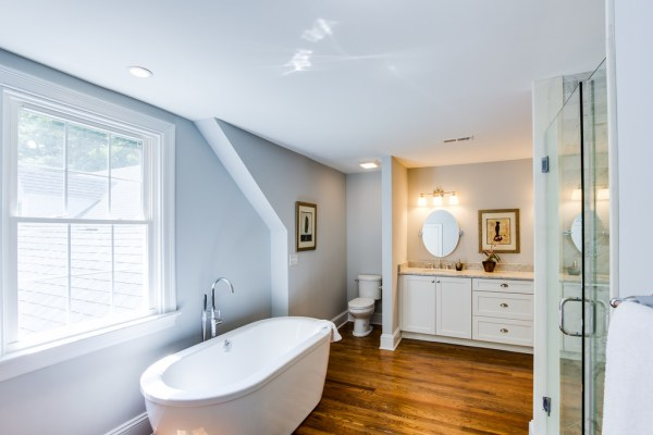 (Old Springs) bright and airy large bathroom renovation with salvaged wood floor @Remodelaholic