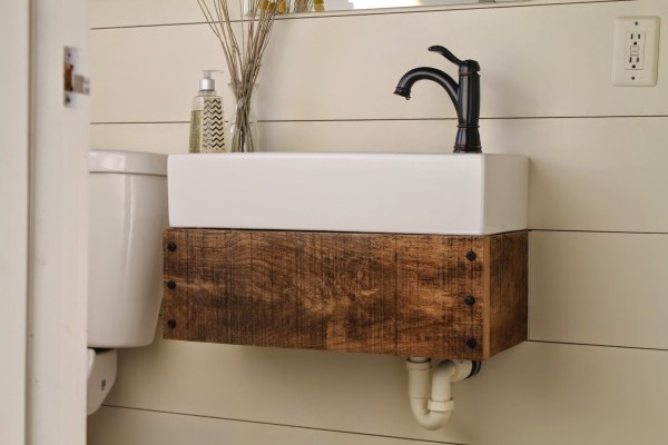 diy floating reclaimed wood vanity with IKEA sink - Girl Meets Carpenter featured on @Remodelaholic