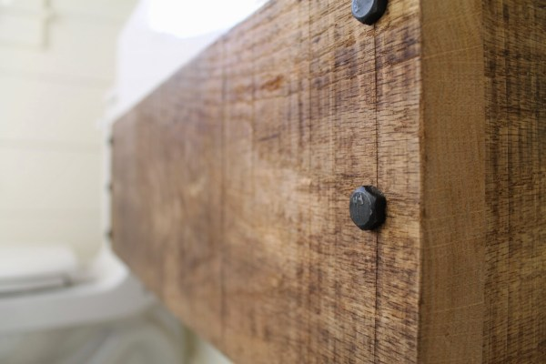 lag bolts for an industrial style floating reclaimed wood vanity - Girl Meets Carpenter featured on @Remodelaholic