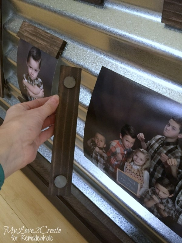 magnetic wood strips on a corrugated metal photo display
