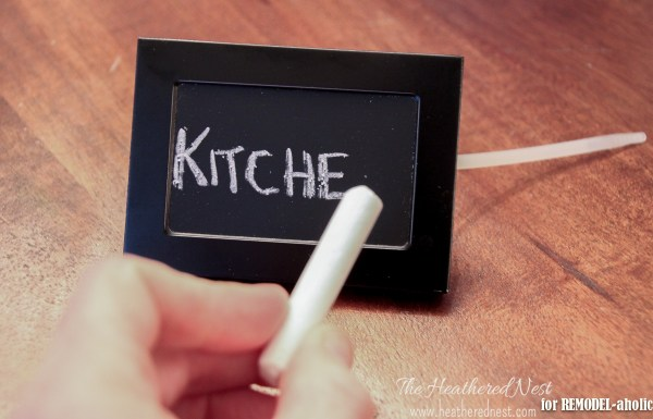 diy rolling wire bins with chalkboard labels made from picture frames - The Heathered Nest on @Remodelaholic