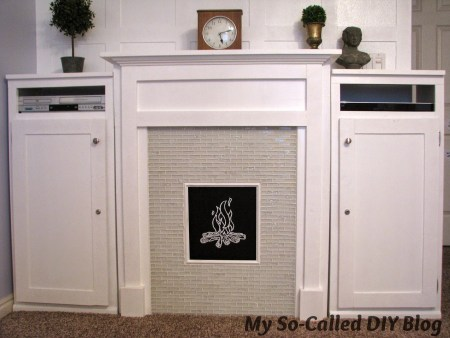 faux fireplace and built-in cabinets - My So-Called DIY Blog on @Remodelaholic