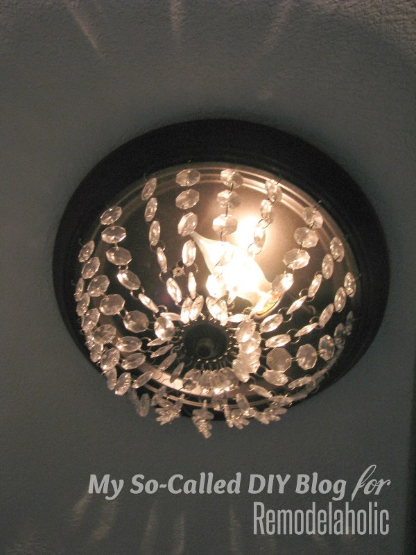 how to update a builder-grade light fixture with hanging crystals - My So-Called DIY Blog on @Remodelaholic