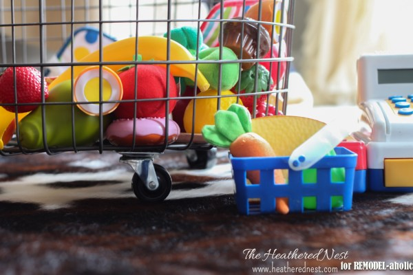 rolling wire bin for toy storage - The Heathered Nest on @Remodelaholic
