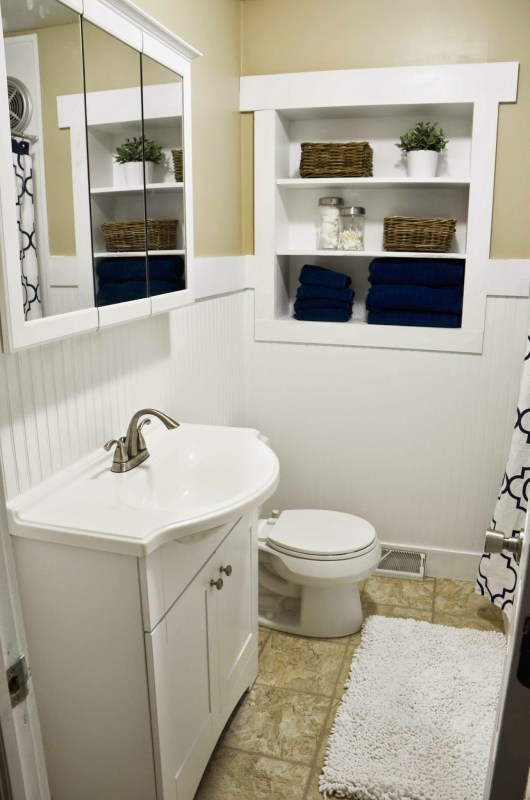 white bathroom remodel with in-wall shelving Since I Became A Mom