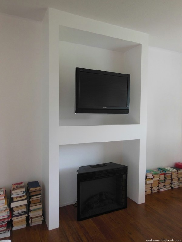 Fireplace and TV Built In by Our Home Notebook featured on Remodelaholic