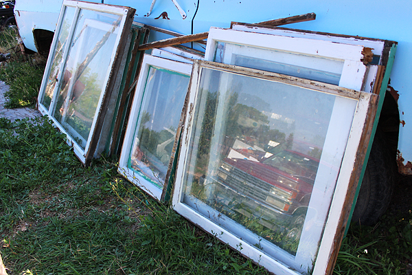 Upcycle Old Windows into Doors for a Storage Unit by Two Feet First featured on @Remodelaholic