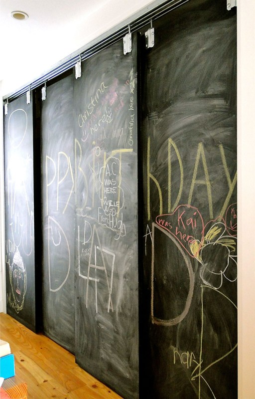 chalkboard bypass pantry doors hung using a barn door track - via Lynne Knowlton