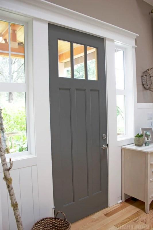 Beautiful Doors - entry door in Benjamin Moore Kendall Charcoal via The Inspired Room