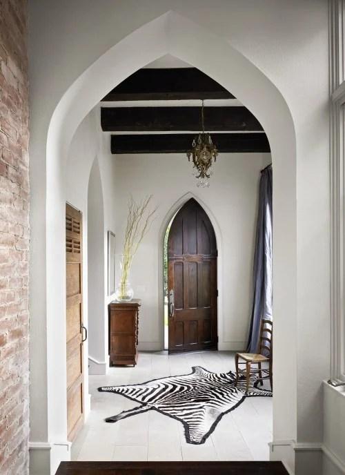 Beautiful Doors - gothic peaked wood entry door via DecorPad
