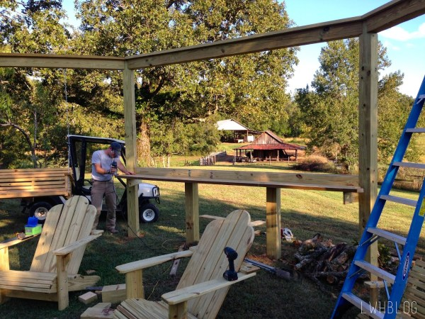Building a Pergola with a Bar and Adirondack Chairs by Little White House Blog featured on @Remodelaholic