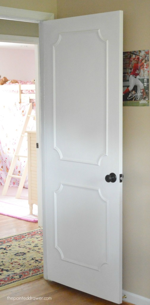 Paneled Door DIY By The Painted Drawer Featured On @Remodelaholic