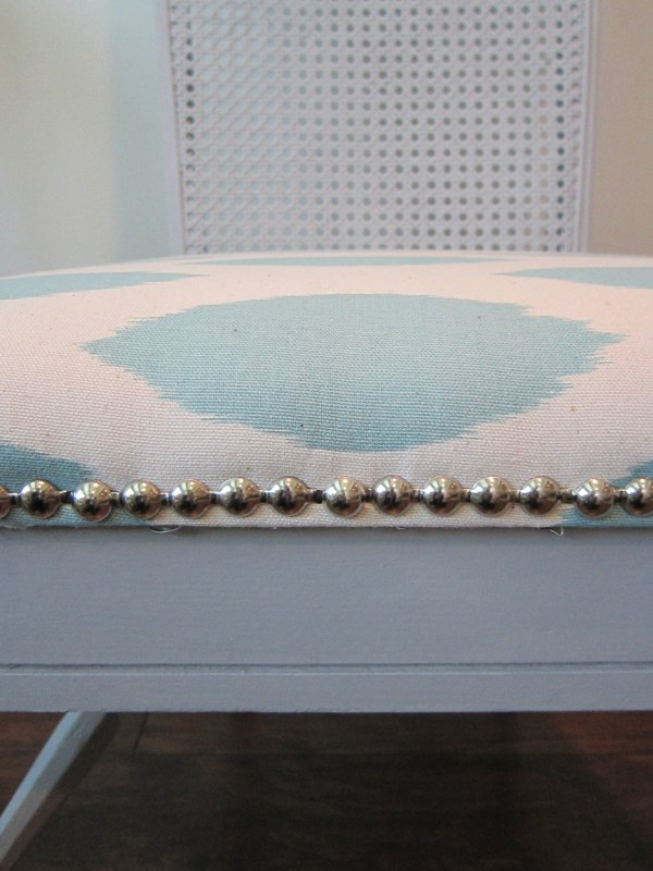 nailhead trim on a gray chair makeover - The Honeycomb Home on @Remodelaholic