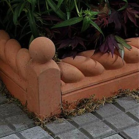 Terra Cotta style garden edging, gardenista, featured on Remodelaholic.com for garden edging ideas