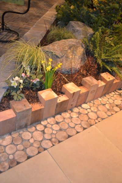 Use multiple materials to create a unique garden edge by Banners by Ricki, featured on Remodelaholic.com
