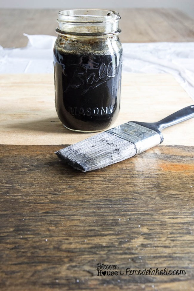 Super easy homemade wood stain using a tea, steel wool, and vinegar combo for a perfect rustic industrial color -- and then paint a chalkboard and add locker baskets to turn it into an awesome mail organizer!