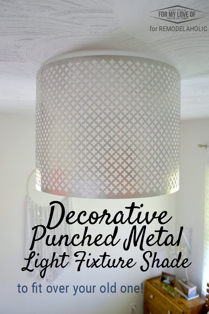 Dress up a basic builder grade light with a DIY punched metal ceiling light shade, made with inexpensive materials you can find at the hardware store. Fits over your existing light so you don't have to worry about electrical and wiring (but always be safe, yo)